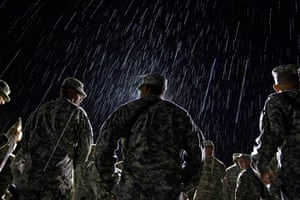 24 hours in pictures: US Army's 4th Brigade Combat Team stand in the rain, Kyrgyzstan