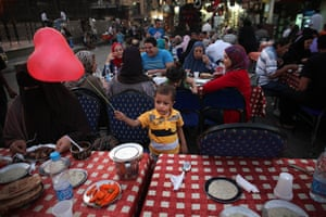 24 hours in pictures: An Egyptian boy plays with a balloon during Iftar, Egypt