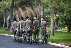 24 hours in pictures: Soldiers go on cleaning duty at the Zhongnanhai leadership compound, China