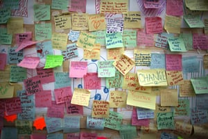 24 hours in pictures: Store in Peckham carries notes of peace after the riots around the UK