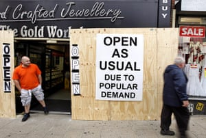 London riots aftermath: A Jewellery shop employee stands outside the shop