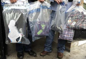 London riots aftermath: Pimlico, London: Goods believed to have been stolen are held by police