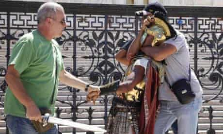 Italian undercover police arrest a phony gladiator outside the Colosseum in Rome