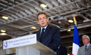 France's President Sarkozy delivering a speech aboard the aircraft carrier Charles de Gaulle