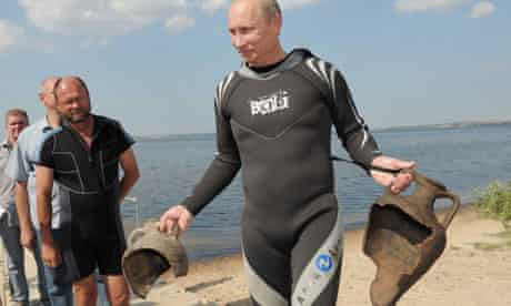 Vladimir Putin carries his archaelogical trophies from a dive in the Black Sea