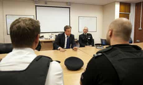 David Cameron talks to policemen