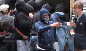 Youths loot a Carhartt store in Hackney, east London