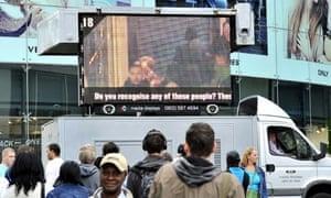 A 'digi-van' in Birmingham displays images of alleged looters