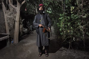 24 Hours: -Afghan warlord Haji Tor Gani poses with his Russian assault rifle