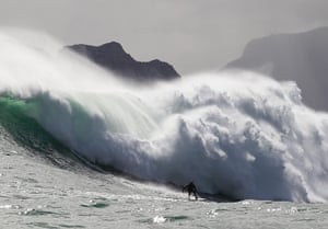 24 hours in pictures: Cape Town, South Africa: Mike Schlebach from South Africa surfs a wave
