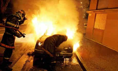 Firefighters tackle a burning car in Toulouse