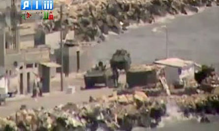 Image grab from YouTube video shows what appears to be Syrian armoured vehicles in Latakia