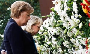 Angela Merkel attends a wreath-laying ceremony