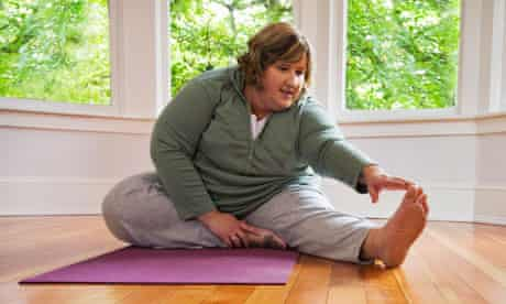 Woman exercising in her front room