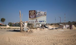 A sign promotes a new housing project at a construction site in Ariel