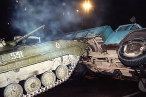 Moscow  coup: 20 August: A Soviet Army tank pushes over a truck