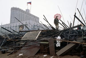 Moscow  coup: 21 August: A Red Army soldier holds an umbrella on a barricade