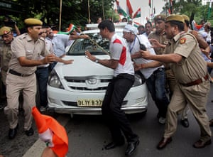 Anna Hazare : Supporters try to stop the car carrying Indian rights activist Anna Hazare