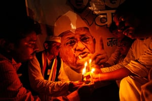 Anna Hazare : Supporters Anna Hazare hold a candlelight vigil in Allahabad