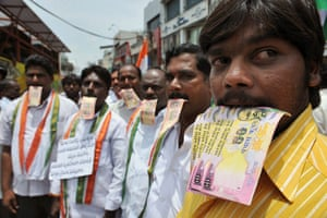 Anna Hazare : Supporters Anna Hazare pose with fake rupee notes at a rally in Hyderabad