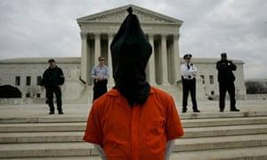 Demonstrator dressed as Abu Ghraib prisoner