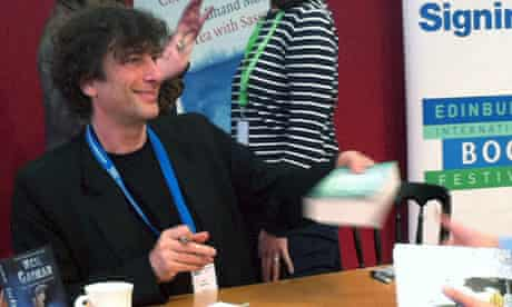 Neil Gaiman signing books for fans at the Edinburgh international book festival
