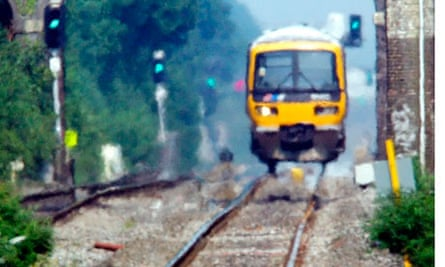 Rails appear buckled in front of approaching train