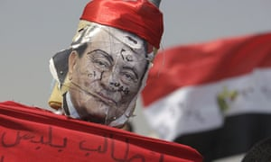 A defaced image of former Egyptian president Hosni Mubarak