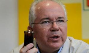 Venezuela's energy minister, Rafael Ramírez, holding up a vial of crude oil
