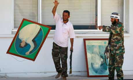 Rebel fighters with posters of Muammar Gaddafi, 18 August 2011