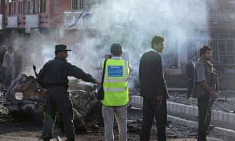 Police investigators inspect the site of a suicide attack in Kabul