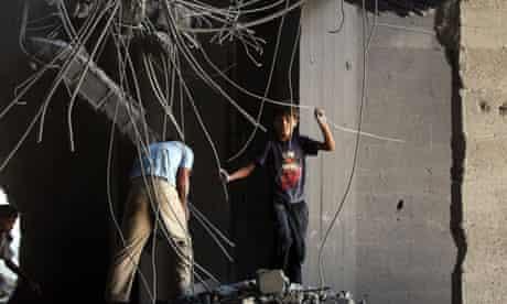 Palestinian boys play in a Hamas building in Gaza City