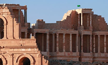 A Libyan national flag flies over the ruins of a theatre in Sabratha