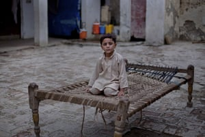 FTA: Adrees Latif   : Inamullah, 5, poses for a portrait in the same courtyard