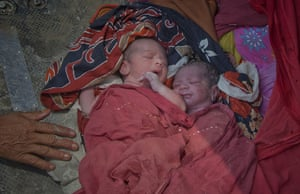 FTA: Adrees Latif   : Newborn twins after they were evacuated from their flooded village
