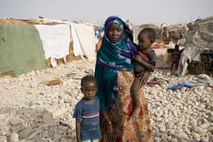 Puntland Somalia : Asmara with her two children in one of the IDP camps in Bosaso