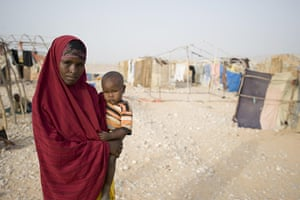 Puntland Somalia : Norta Omar, 26 with her youngest child Faisal Kasim, two