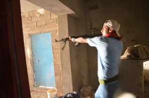 Libya: A Libyan rebel fights in Zawiyah