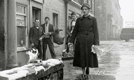 Jim Haynes, second left, watches the book burning outside his shop