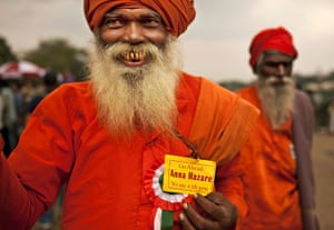 24 hours in pictures: New Delhi, India: A Hindu holy man loyal to Anna Hazare shows his support