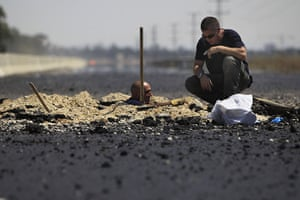 24 hours in pictures: Kiryat Gat, Israel: Israeli police sappers inspect the remains of a rocket