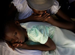 24 hours in pictures: Port-au-Prince, Haiti: Girls rest during a gathering of schools