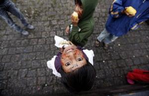 24 hours in pictures: Sao Paulo, Brazil: Brazilian indigenous children eat corn