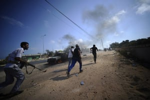 24 hours in pictures: Gadayem forest, Libya: Libyan rebels run for cover during fighting