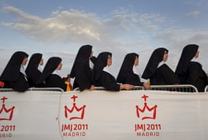 24 hours in pictures: Madrid, Spain: Nuns wait for the Pope Benedict XVI