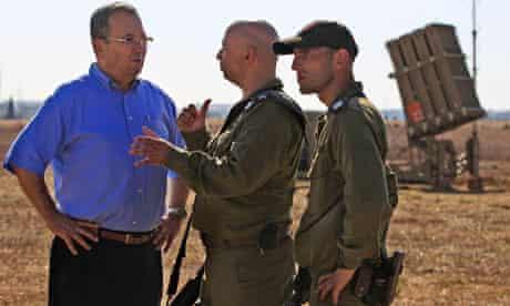 Ehud Barak, the Israeli defence minister, talks to soldiers in Ashkelon