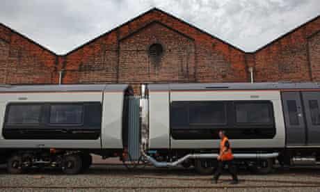 Bombadier employee walks past a train