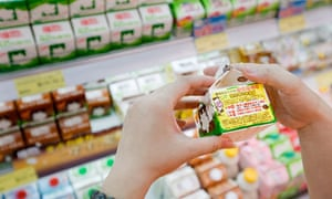 A Chinese shopper checks milk products