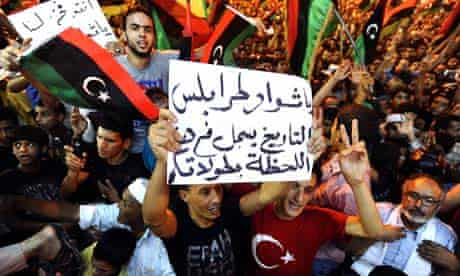 Libyans celebrate the capture in Tripoli of Muammar Gaddafi's son Saif al-Islam