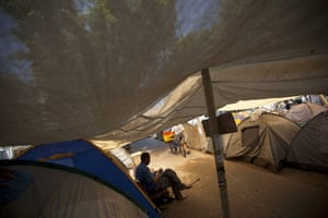 FTA: Oded Balilty: An Israeli man rests by a tent in a camp to protest